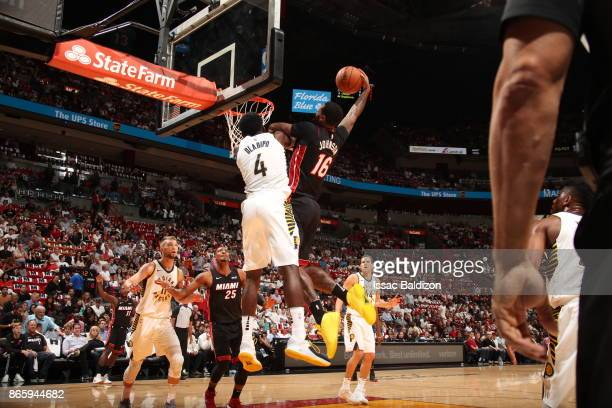 James Johnson of the Miami Heat dunks against Victor Oladipo of the Indiana Pacers on October 21 2017 at American Airlines Arena in Miami Florida...