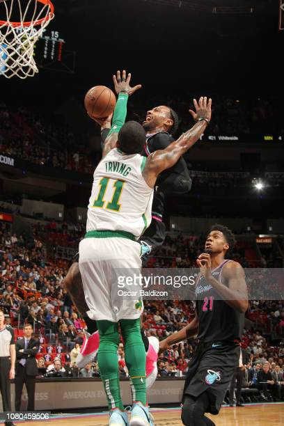 James Johnson of the Miami Heat dunks the ball against Kyrie Irving of the Boston Celtics on January 10 2019 at American Airlines Arena in Miami...