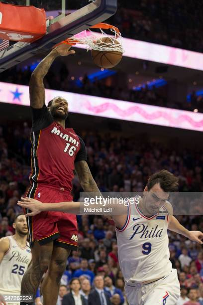 James Johnson of the Miami Heat dunks the ball past Dario Saric of the Philadelphia 76ers in the fourth quarter during Game Two of the first round of...