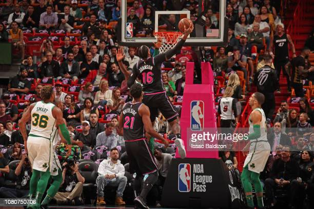 James Johnson of the Miami Heat dunks the ball while guarded by Kyrie Irving of the Boston Celtics on January 10 2019 at American Airlines Arena in...