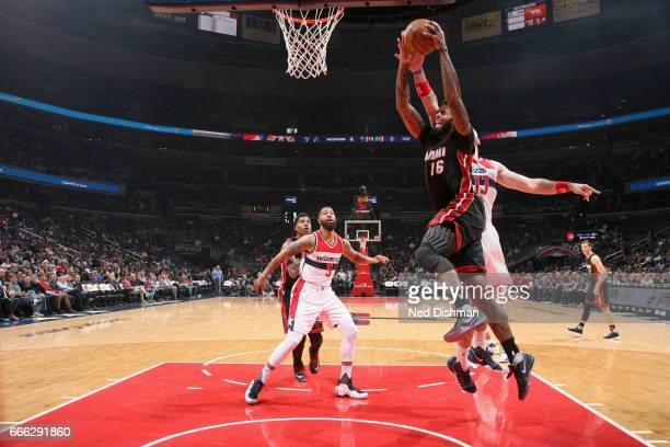 James Johnson of the Miami Heat goes to the basket against the Washington Wizards on April 8 2017 at Verizon Center in Washington DC NOTE TO USER...