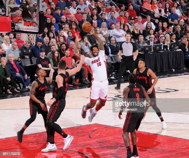 James Johnson of the Miami Heat grabs the rebound against the Portland Trail Blazers on March 12 2018 at the Moda Center in Portland Oregon NOTE TO...
