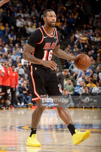 James Johnson of the Miami Heat handles the ball against the Golden State Warriors on November 6 2017 at ORACLE Arena in Oakland California NOTE TO...
