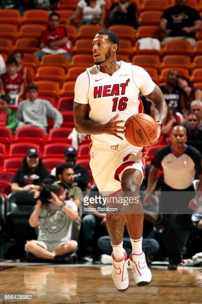 James Johnson of the Miami Heat handles the ball during the preseason game against the Atlanta Hawks on October 1 2017 at American Airlines Arena in...