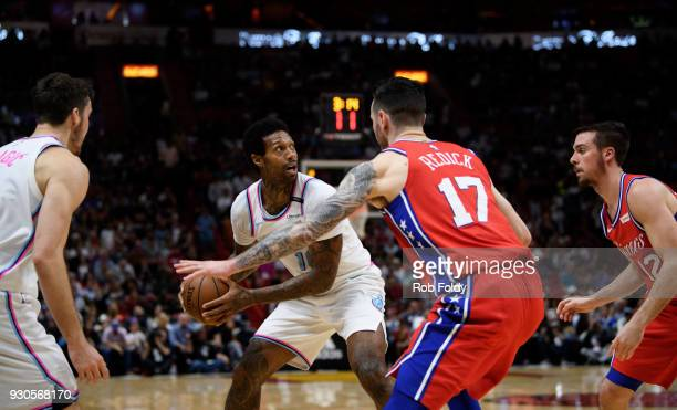 James Johnson of the Miami Heat is defended by JJ Redick and TJ McConnell of the Philadelphia 76ers during the game at American Airlines Arena on...