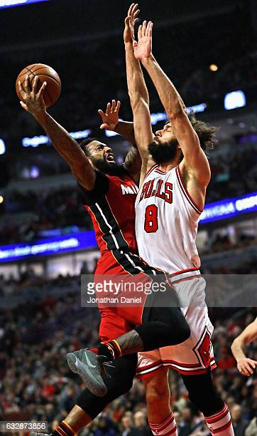 James Johnson of the Miami Heat puts up a shot against Robin Lopez of the Chicago Bulls at the United Center on January 27 2017 in Chicago Illinois...