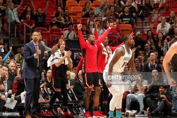 James Johnson of the Miami Heat reacts to a play against the Charlotte Hornets on December 1 2017 at American Airlines Arena in Miami Florida NOTE TO...