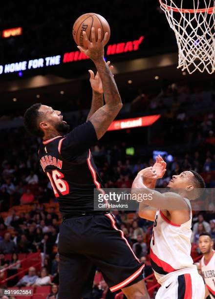 James Johnson of the Miami Heat shoots against CJ McCollum of the Portland Trail Blazers in the second quarter at American Airlines Arena on December...