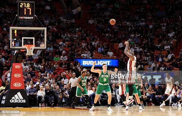 James Johnson of the Miami Heat shoots during a game against the Boston Celtics at American Airlines Arena on November 28 2016 in Miami Florida NOTE...