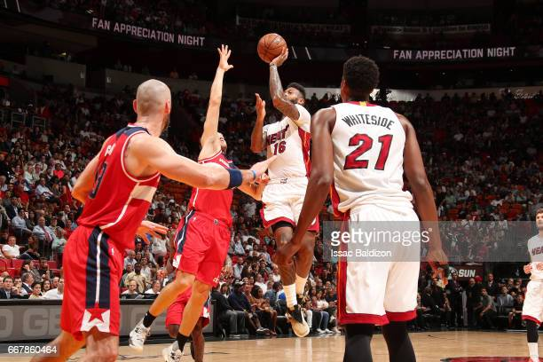 James Johnson of the Miami Heat shoots the ball during the game against the Washington Wizards on April 12 2017 at AmericanAirlines Arena in Miami...