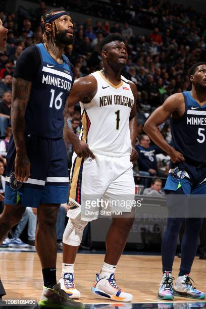 James Johnson of the Minnesota Timberwolves and Zion Williamson of the New Orleans Pelicans look on during the game on March 8 2020 at Target Center...