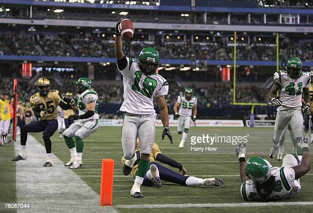 James Johnson of the Saskatchewan Rough Riders celebrates his interception for a touchdown to tie the game 7-7 against the Winnipeg Blue Bombers...