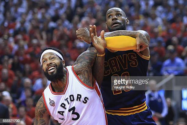 James Johnson of the Toronto Raptors and LeBron James of the Cleveland Cavaliers battle for position during a free throw in the first half in game...