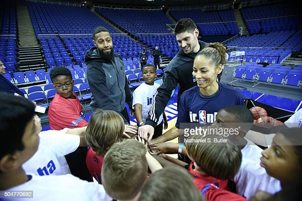 James Johnson of the Toronto Raptors and Nikola Vucevic of the Orlando Magic and WNBA Legend Allison Feater huddles up with the kids during the Jr...