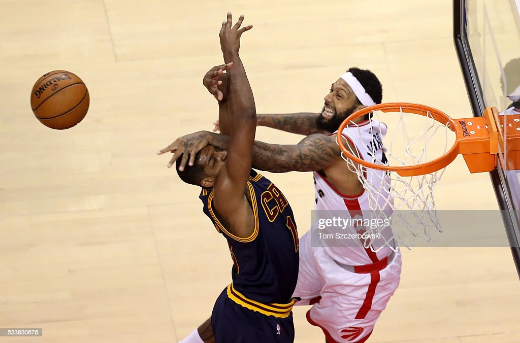 James Johnson #3 of the Toronto Raptors and Tristan Thompson #13 of the Cleveland Cavaliers go for a rebound in the first half in game four of the Eastern Conference Finals during the 2016 NBA Playoffs at the Air Canada Centre on May 23, 2016 in Toronto, Ontario, Canada.