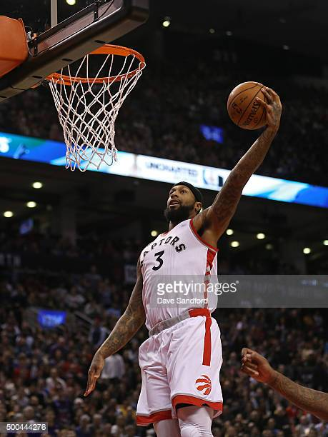 James Johnson of the Toronto Raptors drives to the basket against the Golden State Warriors on December 5 2015 at Air Canada Centre in Toronto...