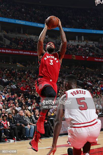 James Johnson of the Toronto Raptors goes for the layup against the Chicago Bulls during the game on December 28 2015 at United Center in Chicago...