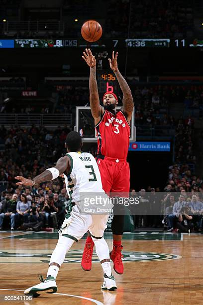 James Johnson of the Toronto Raptors shoots against OJ Mayo of the Milwaukee Bucks during the game on December 26 2015 at BMO Harris Bradley Center...