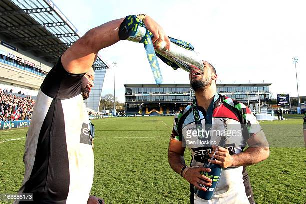 James Johnston and Darryl Marfo of Harlequins celebrate with the trophy following his team's victory during the LV= Cup Final between Sale Sharks and...