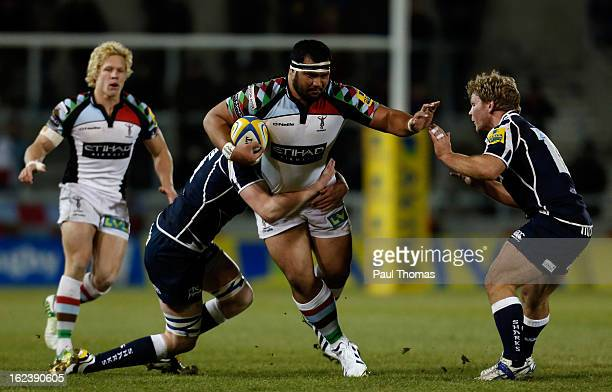 James Johnston of Harlequins is tackled by James Gaskell and Daniel Braid of Sale during the Aviva Premiership match between Sale Sharks and...