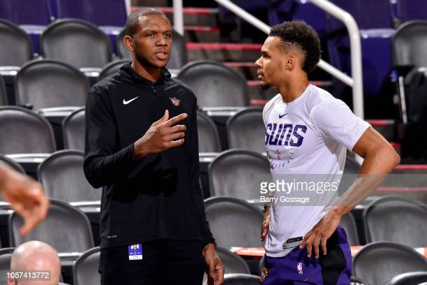 James Jones and Elie Okobo of the Phoenix Suns talk before the game against the Memphis Grizzlies on November 4 2018 at Talking Stick Resort Arena in...