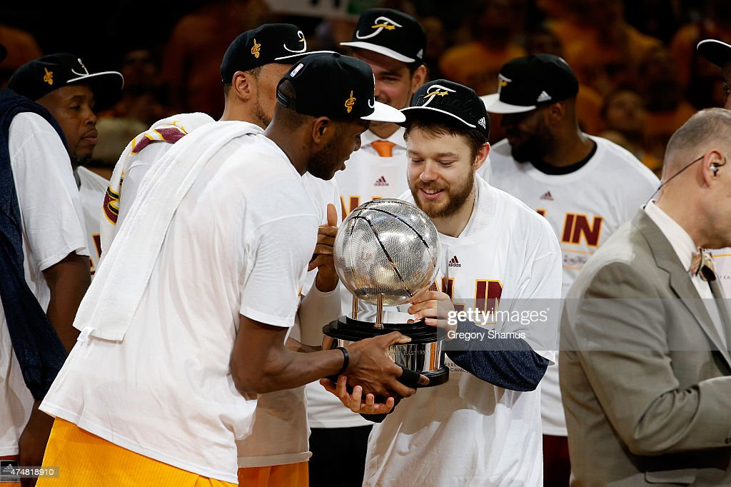 James Jones #1 and Matthew Dellavedova #8 of the Cleveland Cavaliers hold the trophy after defeating the Atlanta Hawks during Game Four of the Eastern Conference Finals of the 2015 NBA Playoffs at Quicken Loans Arena on May 26, 2015 in Cleveland, Ohio. The Cavaliers defeated the Hawks 118-88.