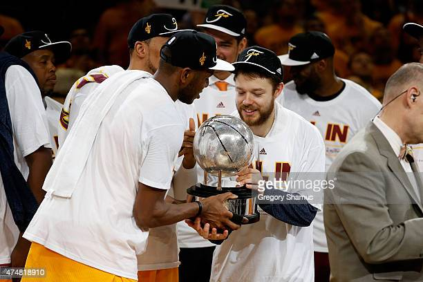 James Jones and Matthew Dellavedova of the Cleveland Cavaliers hold the trophy after defeating the Atlanta Hawks during Game Four of the Eastern...