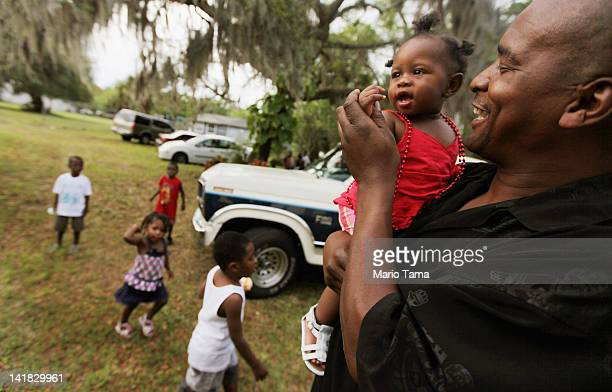 James Jones holds his granddaughter D'kyra Williams at a family birthday party for Ruthie Wilson at the home owned by the Wilsons for over 100 years...