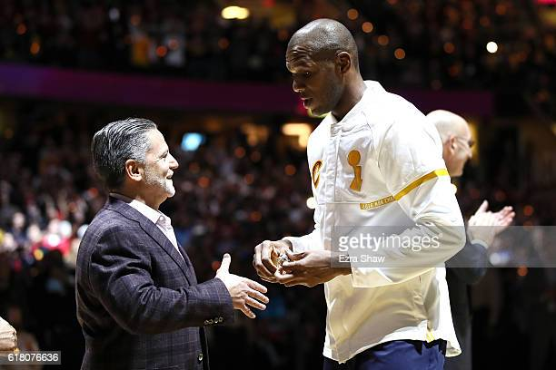 James Jones of the Cleveland Cavaliers receives his championship ring from owner Dan Gilbert before the game against the New York Knicks at Quicken...