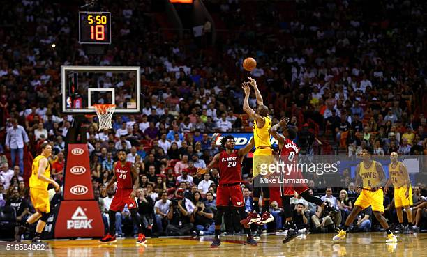 James Jones of the Cleveland Cavaliers shoots over Justise Winslow of the Miami Heat during a game at American Airlines Arena on March 19 2016 in...