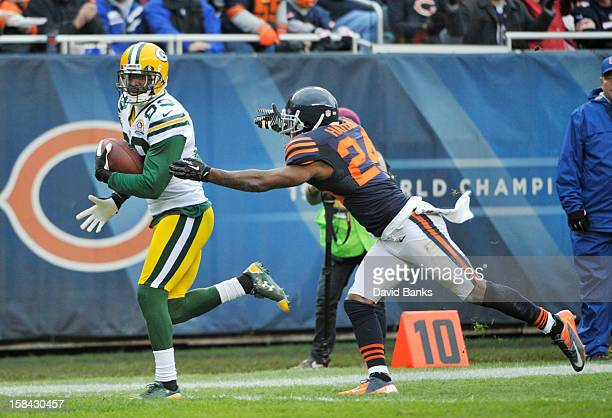 James Jones of the Green Bay Packers catches a touchdown as Kelvin Hayden of the Chicago Bears defends him on December 16 2012 at Soldier Field in...
