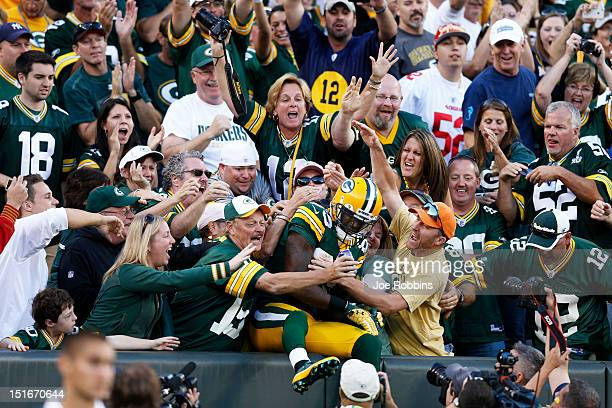 James Jones of the Green Bay Packers celebrates with fans after catching a 10yard touchdown pass in the fourth quarter of the game against the San...