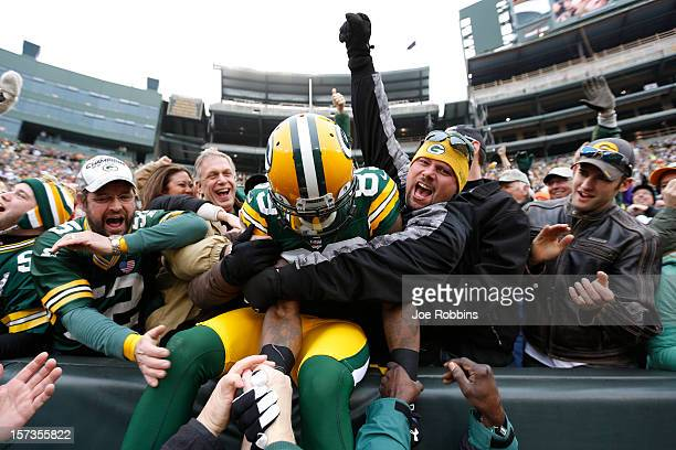 James Jones of the Green Bay Packers celebrates with fans after a 32yard touchdown reception against the Minnesota Vikings during the first half of...