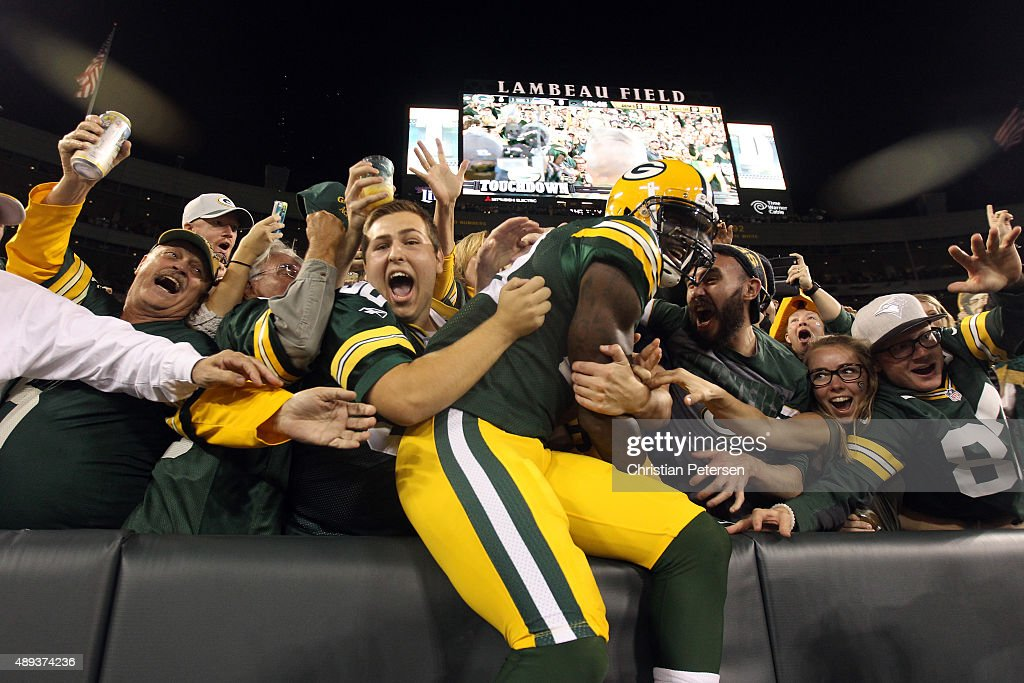 James Jones #89 of the Green Bay Packers celebrates with fans after scoring a touchdown thrown by Aaron Rodgers #12 in the first quarter against the Seattle Seahawks during their game at Lambeau Field on September 20, 2015 in Green Bay, Wisconsin.