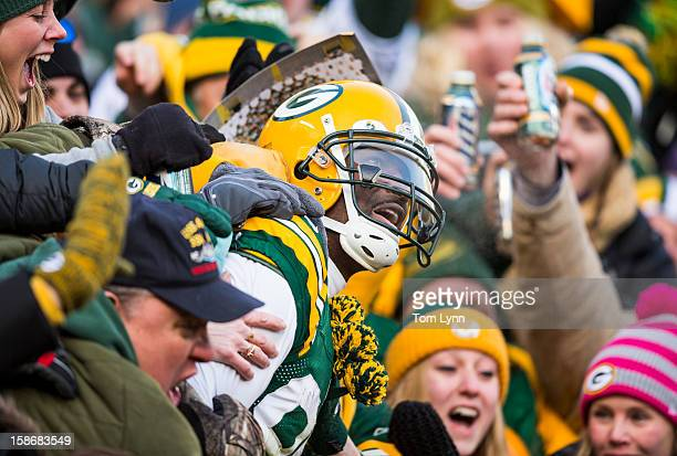 James Jones of the Green Bay Packers enjoys a Lambeau Leap after scoring a touchdown against the Tennessee Titans at Lambeau Field on December 23...