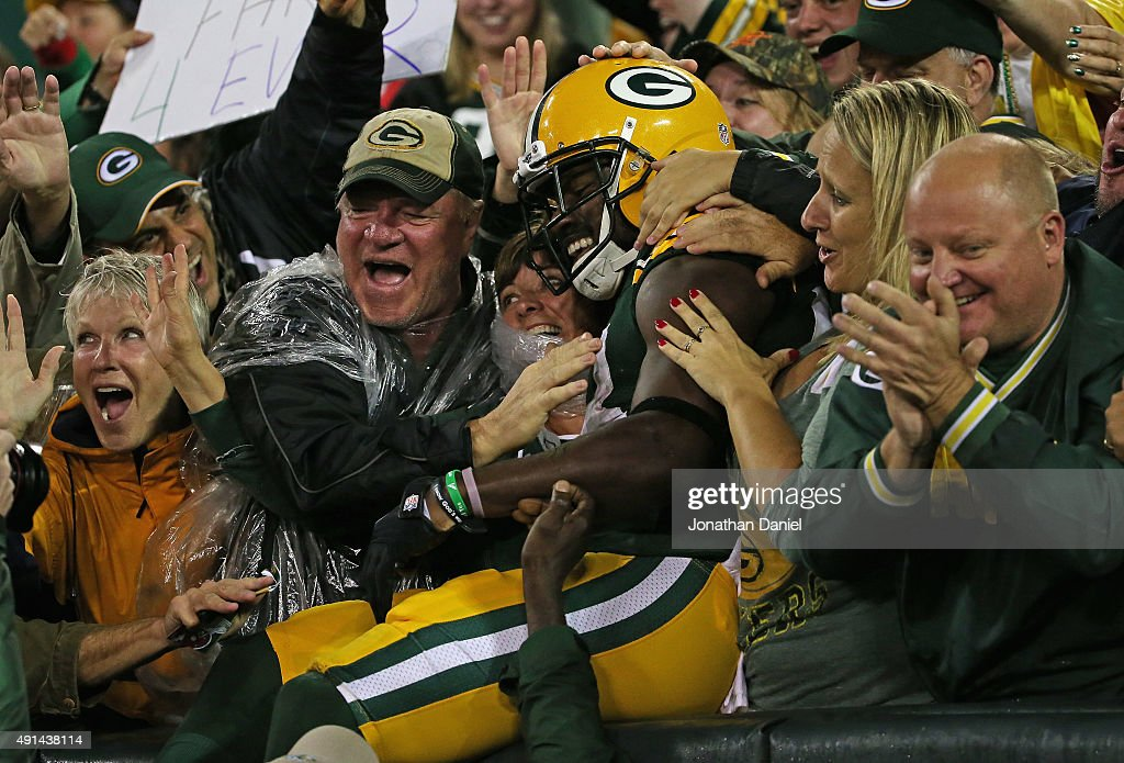 James Jones #89 of the Green Bay Packers leaps into the stands after scoring a touchdown against the Kansas City Chiefs at Lambeau Field on September 28, 2015 in Green Bay, Wisconsin. The Packers defeated the Chiefs 38-28.