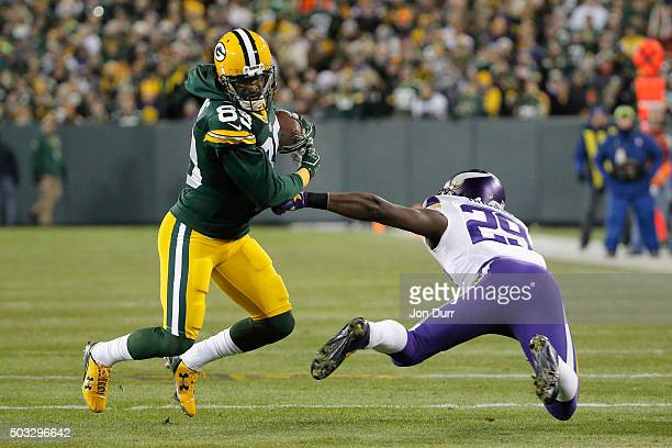 James Jones of the Green Bay Packers runs with the ball as Xavier Rhodes of the Minnesota Vikings attempts to tackle him during the first quarter of...