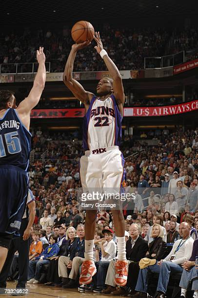 James Jones of the Phoenix Suns shoots a jump shot against Matt Harpring of the Utah Jazz during a game at U.S. Airways Center on February 3 in...