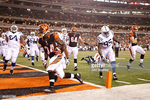 James Jr Wilder of the Cincinnati Bengals runs the ball into the end zone for a touchdown during the fourth quarter against the Indianapolis Colts at...