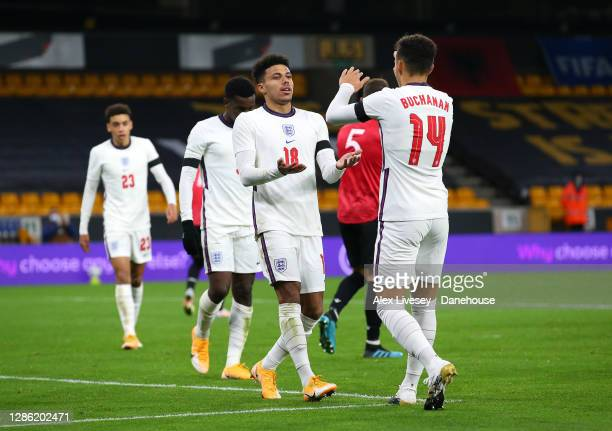 James Justin of England U21 celebrates with Lee Buchanan after scoring their second goal during the UEFA Euro Under 21 Qualifier match between...