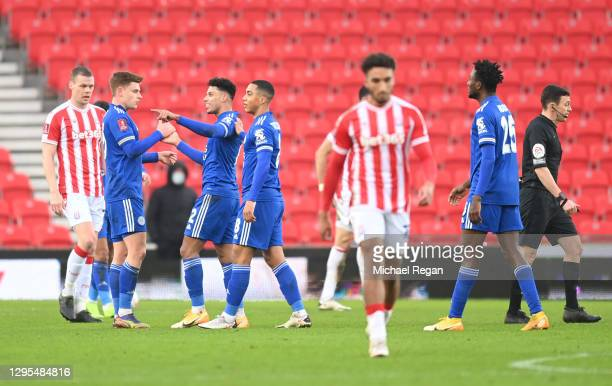 James Justin of Leicester City celebrates with teammates Harvey Barnes and Youri Tielemans after scoring his team's first goal during the FA Cup...