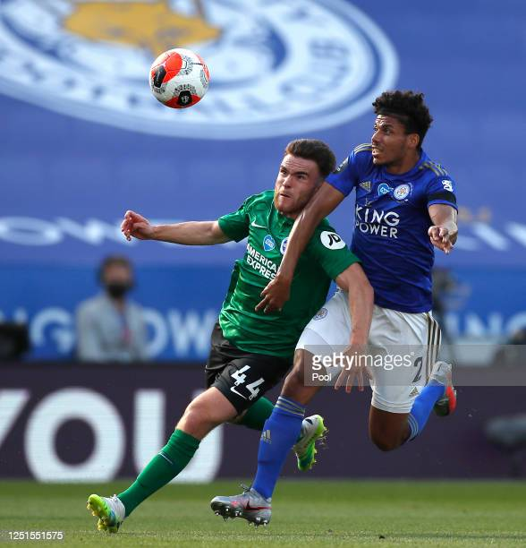 James Justin of Leicester City fouls Aaron Connolly of Brighton and Hove Albion in the area which leads to a penalty awarded to Brighton and Hove...