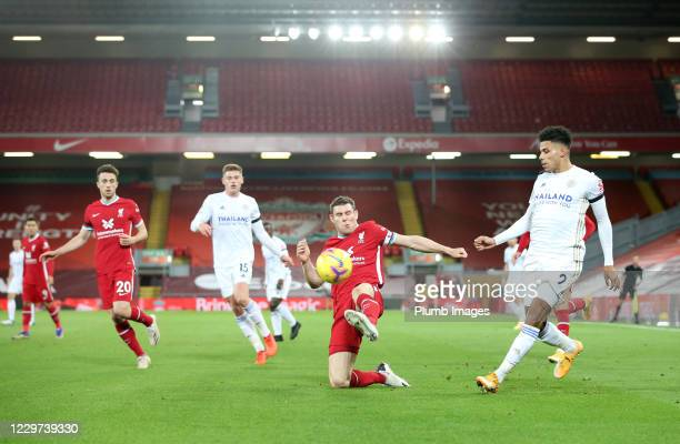 James Justin of Leicester City in action with James Milner of Liverpool during the Premier League match between Liverpool and Leicester City at...