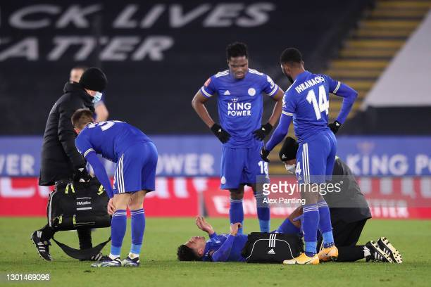 James Justin of Leicester City receives medical treatment as Daniel Amartey and Kelechi Iheanacho look on during The Emirates FA Cup Fifth Round...