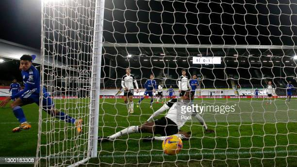 James Justin of Leicester City scores their side's second goal whilst under pressure from Tosin Adarabioyo of Fulham during the Premier League match...