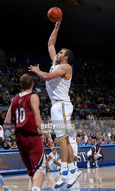 James Keefe of of the UCLA Bruins shoots over Brad Sweezy of the Loyola Marymount Lions at Pauley Pavilion December 17 2008 in Westwood California...
