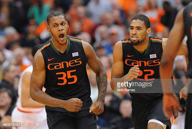 James Kelly and Donnavan Kirk of the Miami Hurricanes react to a play against the Syracuse Orange during the second half at the Carrier Dome on...