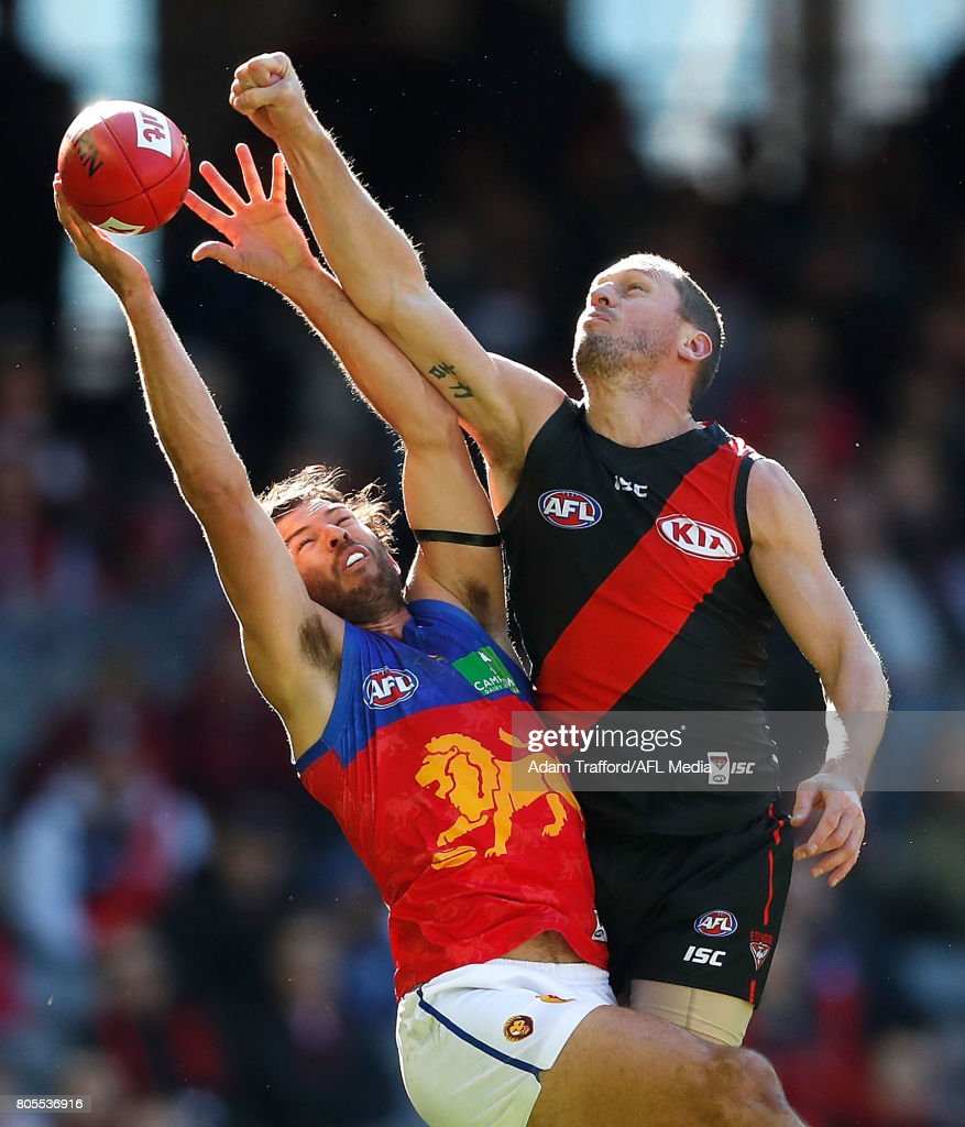 James Kelly of the Bombers and Rohan Bewick of the Lions compete for the ball during the 2017 AFL round 15 match between the Essendon Bombers and the Brisbane Lions at Etihad Stadium on July 02, 2017 in Melbourne, Australia.