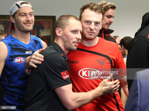 James Kelly of the Bombers is hugged by teammate Brendon Goddard after a press conference to announce his retirement at the Essendon Football Club on...