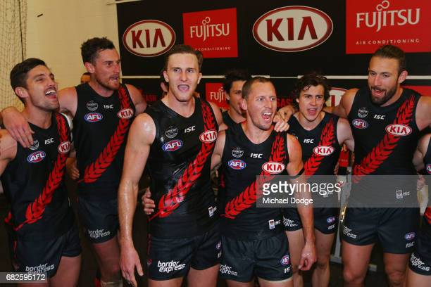 James Kelly of the Bombers sing the club song after winning in his 300th match with James Stewart during the round eight AFL match between the...